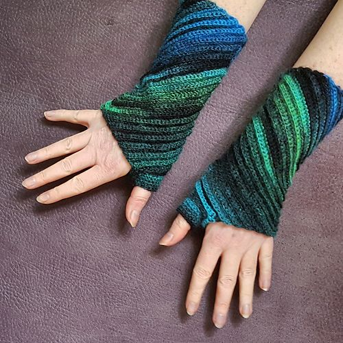 These wrist warmers are worked in one piece - starting from the ...