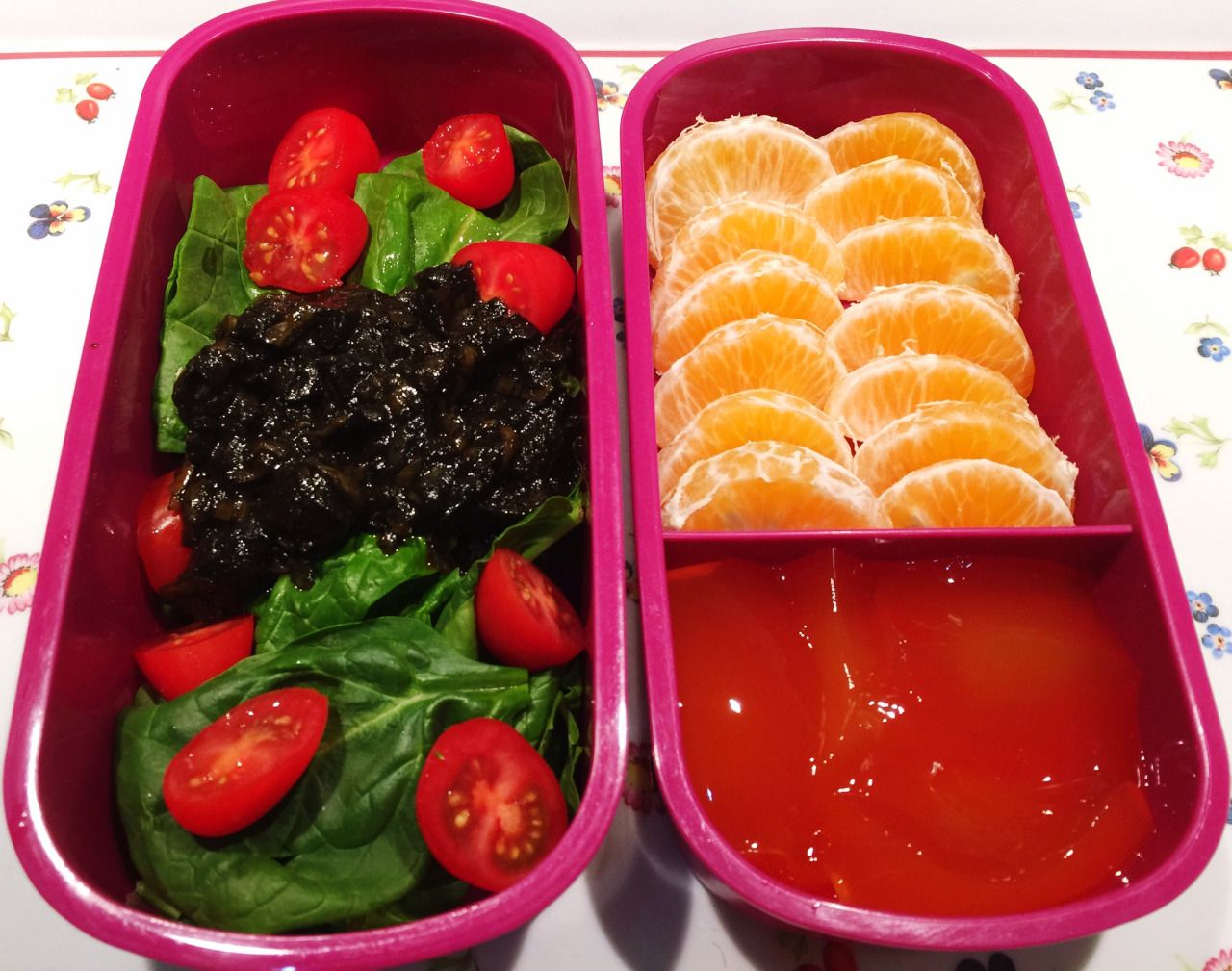 Hers; squid in ink salad, sugar free raspberry jelly and a clementine