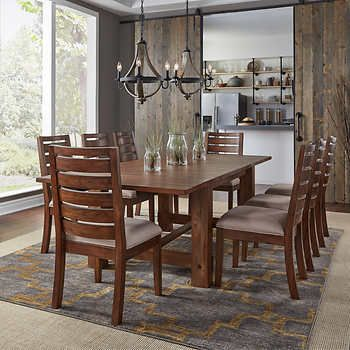 Corrine 9 Piece Dining Set Features Table And 8 Chairs Solid
