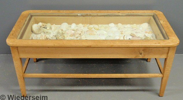 33 Blonde wood curio cased coffee table with seashell on Blonde