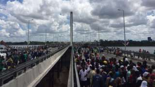 """Image caption                     The president says it should be named after Tanzania's founding President Julius Nyerere   A cable-stayed bridge, described as East Africa's longest, has opened in Tanzania's main city, Dar es Salaam, to ease over-crowding on ferries.  The 680m (2,230 ft) bridge links the city centre with southern neighbourhoods across the Indian Ocean. Tanzania's leader John Magufuli hailed it as a """"liberation"""