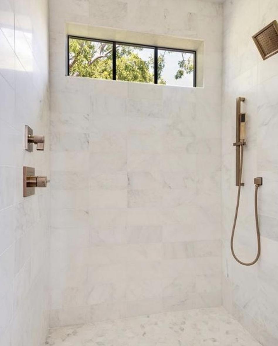 The Versatile Look Of Marble Tile In 2020 Carrara Marble Bathroom Marble Bathroom Marble Subway Tiles