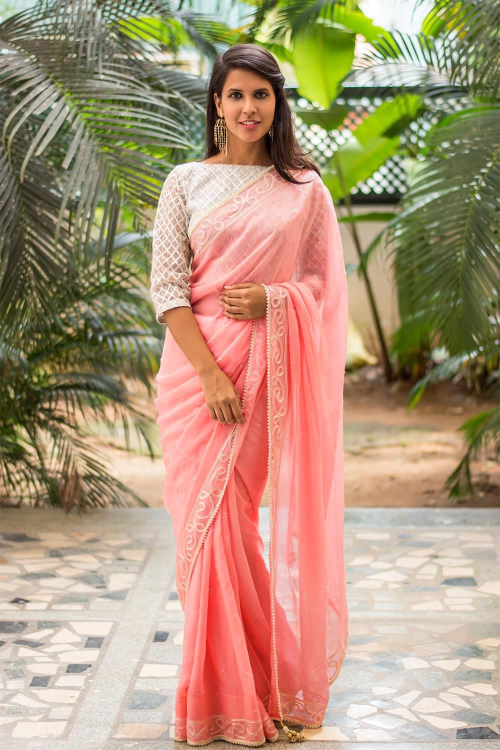 410aa38924ea67 Peachish pink georgette saree with threadwork and pearl border #peach #saree  #houseofblouse