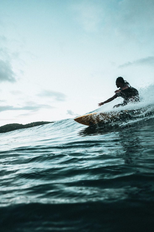man surfboarding during daytime Surfing