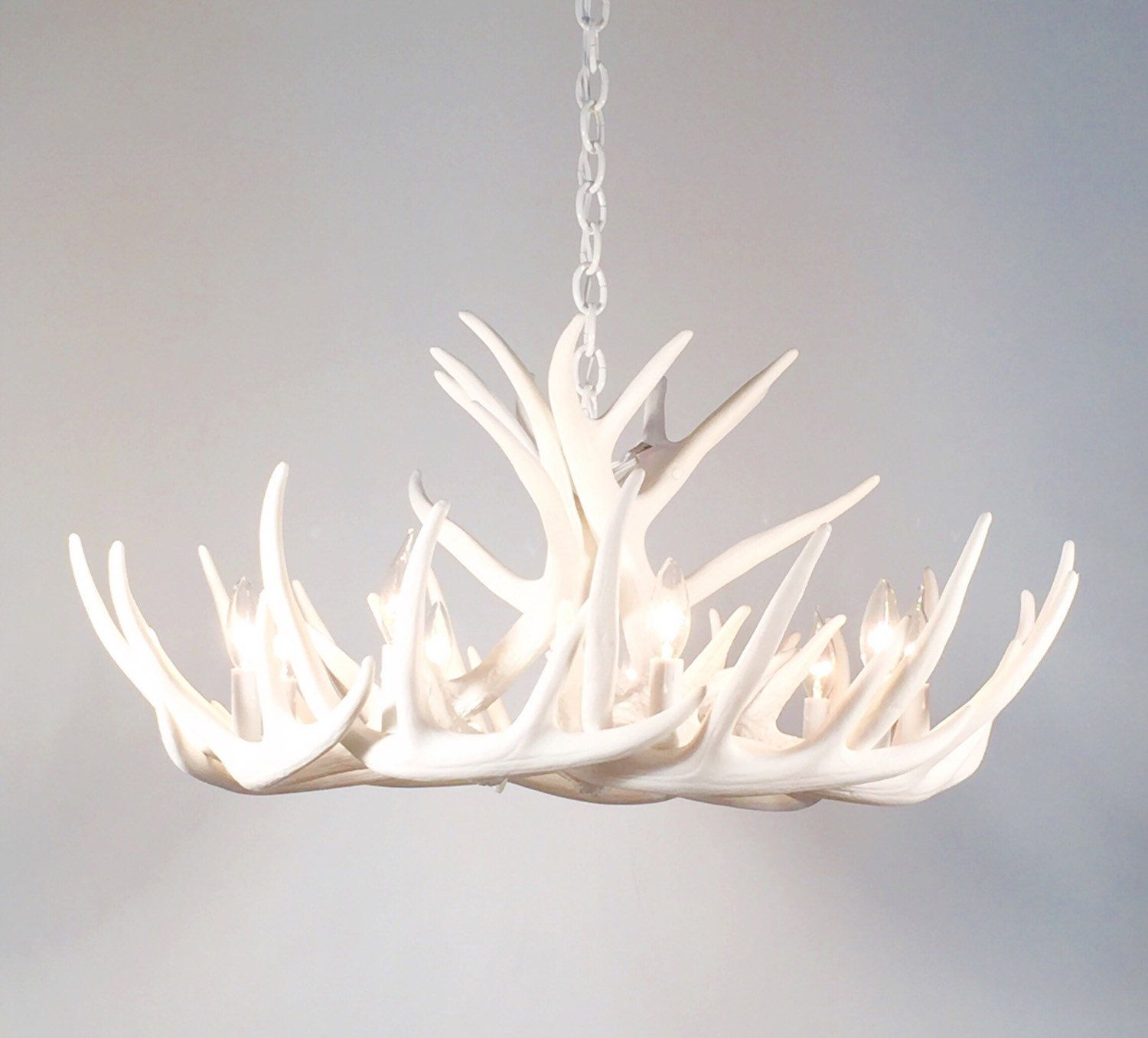 This is an all white antler chandelier made with faux reproduction