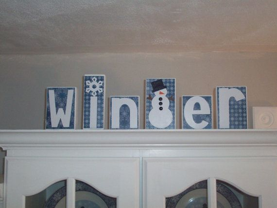 These adorable Winter blocks would look lovely on any table or shelf. They also make a great gift for family and friends.  These blocks are painted white, and are all embellished with blue patterned backgrounds and read Winter in letter appliques on the front, with the t being a snowman with stick arms. They are finished with a protectant coating, and buttons on the snowman.  Each block measures 4 to 6 1/2 inches tall 3 1/2 or 2 1/2 inches wide and 1 1/2 inches thick.  All my items are made…