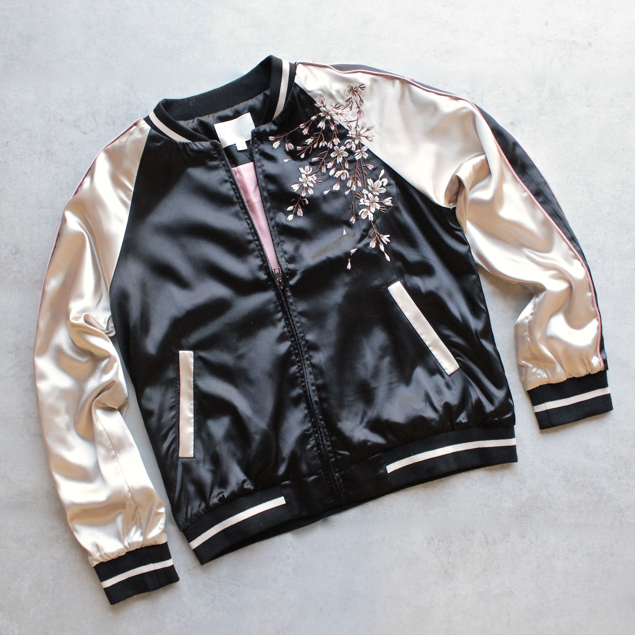 - Satin bomber jacket with contrast paneling and embroidery at front and back. - Hand wash cold. Line dry flat. Iron low heat if needed. - 97% POLYESTER, 3%SPANDEX US S 2-4 M 6-8 L 10-12
