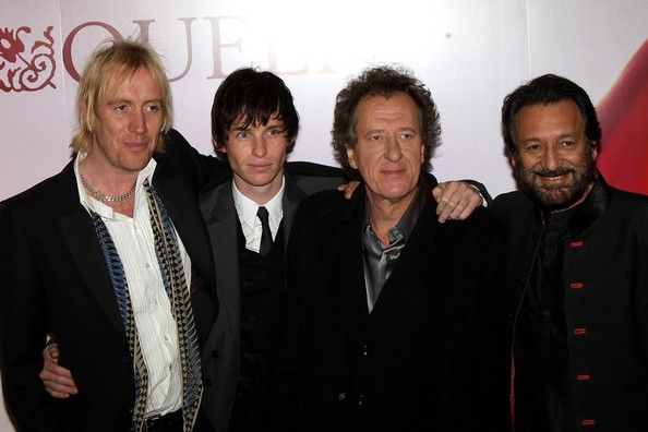 Rhys Ifans, Eddie Redmayne and Geoffrey Rush and director Shekhar Kapur arrive at The Times BFI 51st London Film Festival UK premiere of 'Elizabeth: The Golden Age' at the Odeon Leicester Square on October 23, 2007 in London, England (source: http://www.zimbio.com/photos/Eddie+Redmayne/Rhys+Ifans/Elizabeth+Golden+Age+UK+Film+Premiere/Jhm_I8BEZK7)