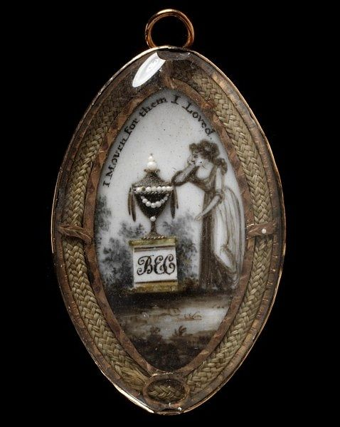 "Mourning locket, England (1775-1800), Victoria & Albert Museum  Memorial jewellery to honour the dead is one of the largest categories of 18th- century jewellery to survive. Many mourning jewels have inscriptions that record the name and dates of the dead person.    ""I mourn for them I loved"""