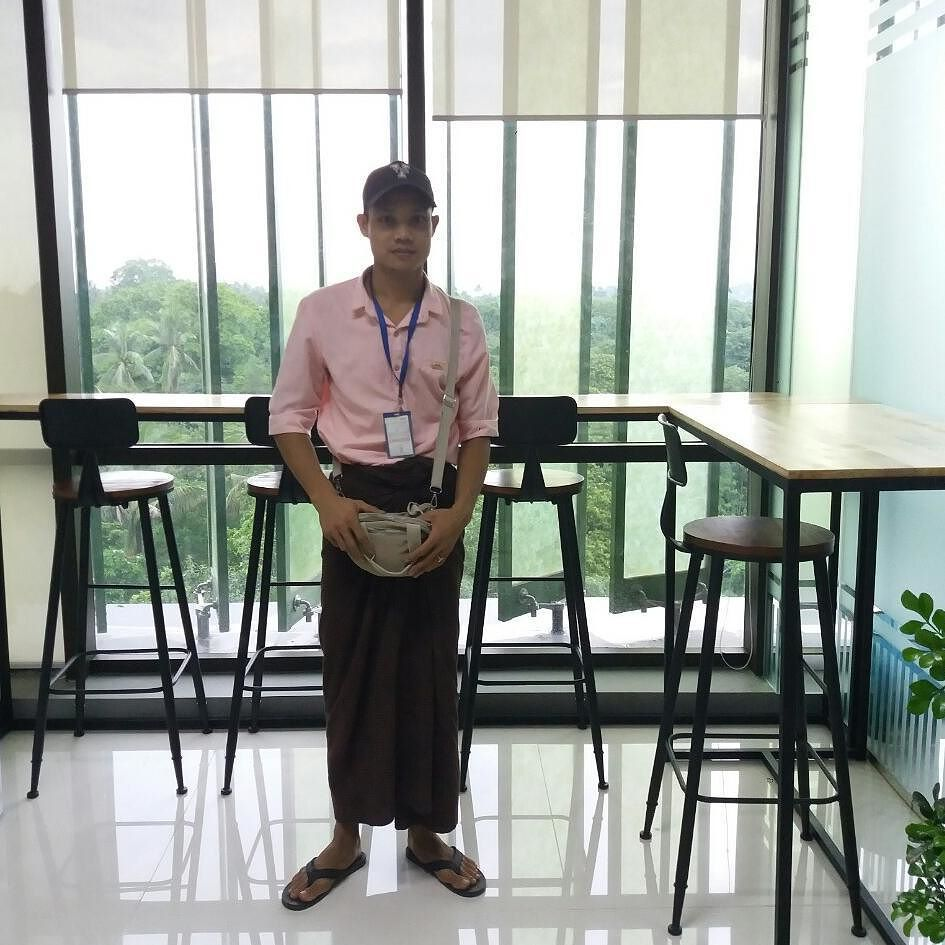 Posing In His Longyi A Burmese Carpenter Is All Smiles After Delivering Office Furniture To French Company Yangon Myanmar The Sleek Design Can Be Used