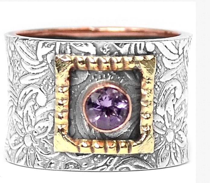 Stunning two tone sterling silver ring with real amethyst.  Only $32.00. At Bangles and Baubles on fb!  Where every purchase provides food and care for a rescue animal! Xo