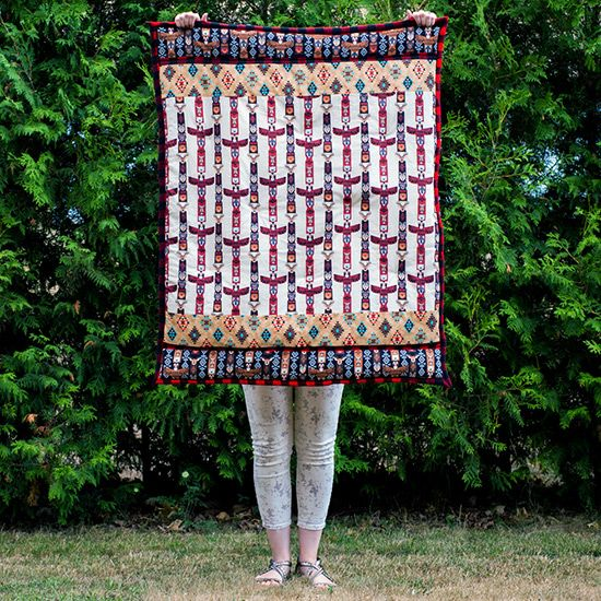Beginners quilting: I used a tutorial I found (link within) to make this adorable crib-sized totem poles & buffalo plaid quilt. Quick project -- took a little longer than a full afternoon to complete. A good idea for a quick baby shower gift if you sew!