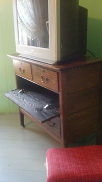 Entertainment center made from old dresser.