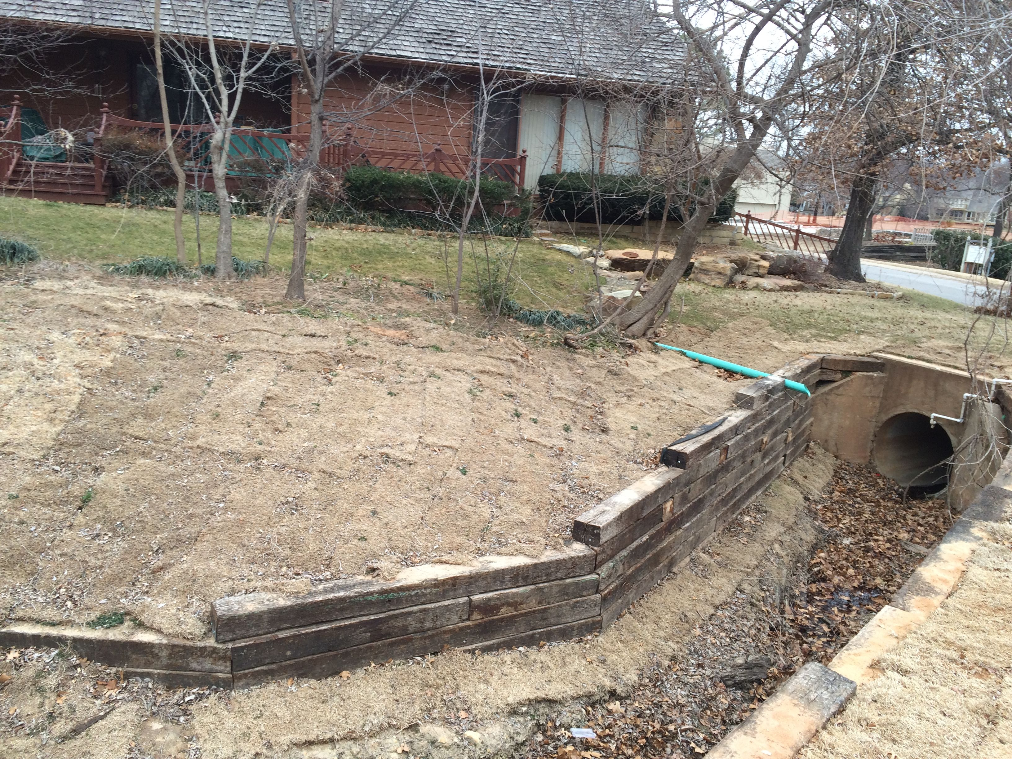 Railroad Tie Retaining Wall Installation In Tulsa Railroad