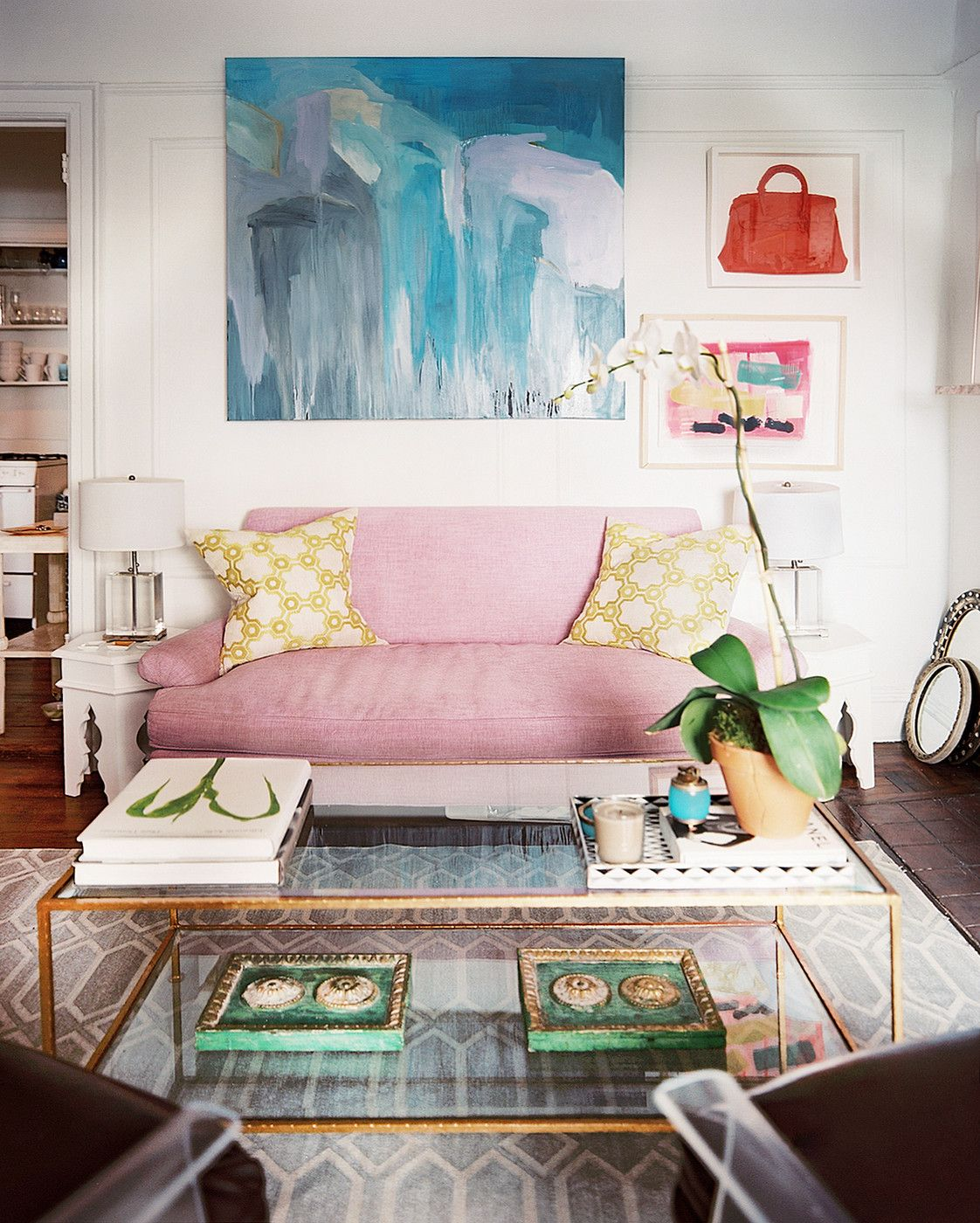 Bohemian Eclectic Vintage Living Room: Artwork Hung Above A Purple Couch .