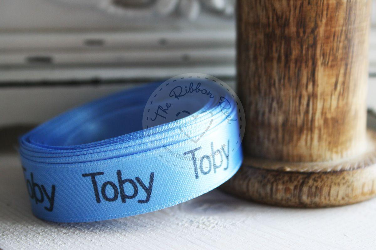 Personalised ribbon printed on mid blue satin ribbon using jet black foil