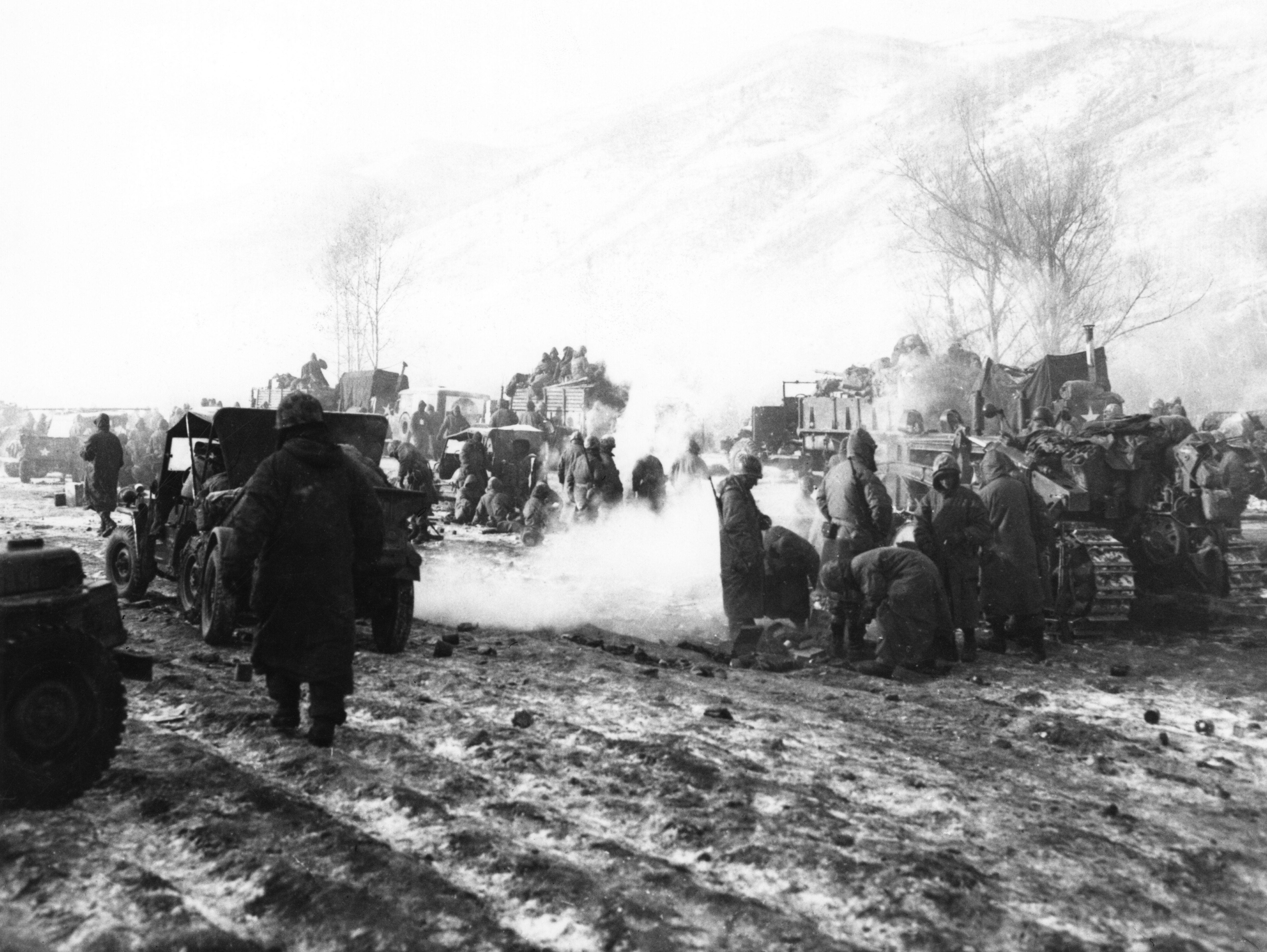 US Marines assemble their vehicles and equipment after a rearguard action against North Korean forces during the Korean War, 19th December 1950.