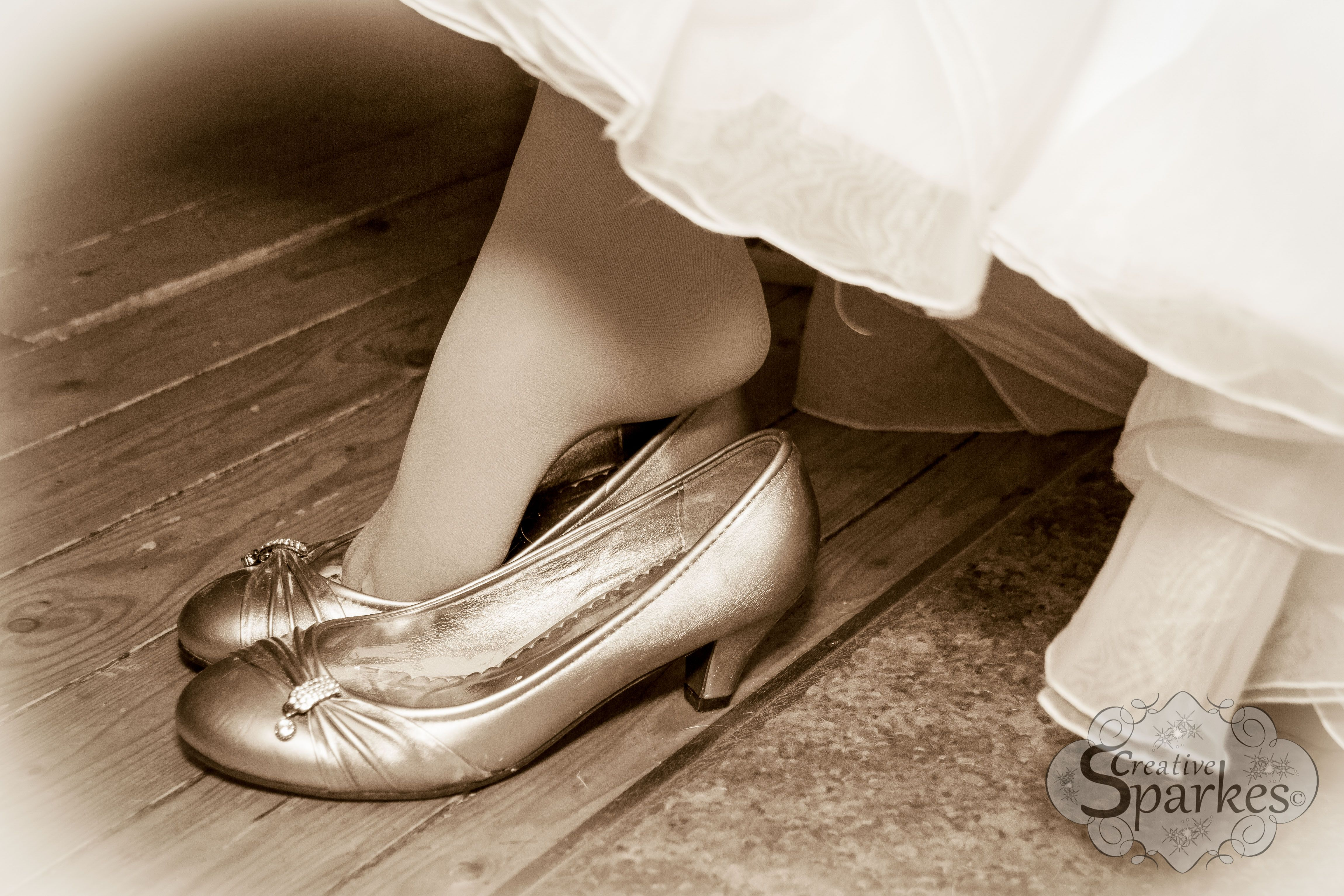 Like Cinderella this beautiful Bride slipped on her shoes, ready for her big day.