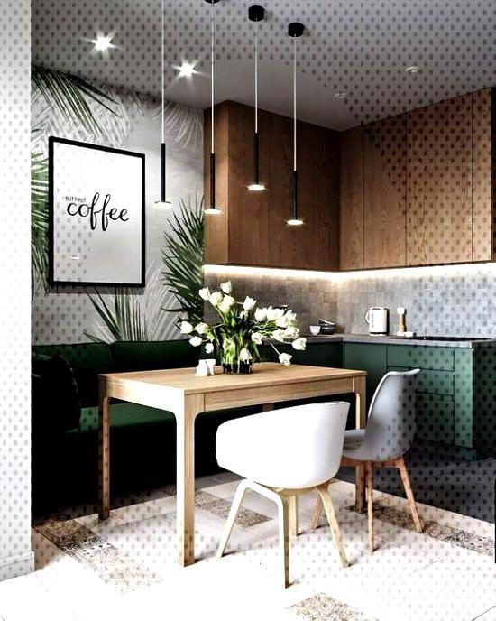 Une cuisine au style design organique dans les tons verts et bois naturel.