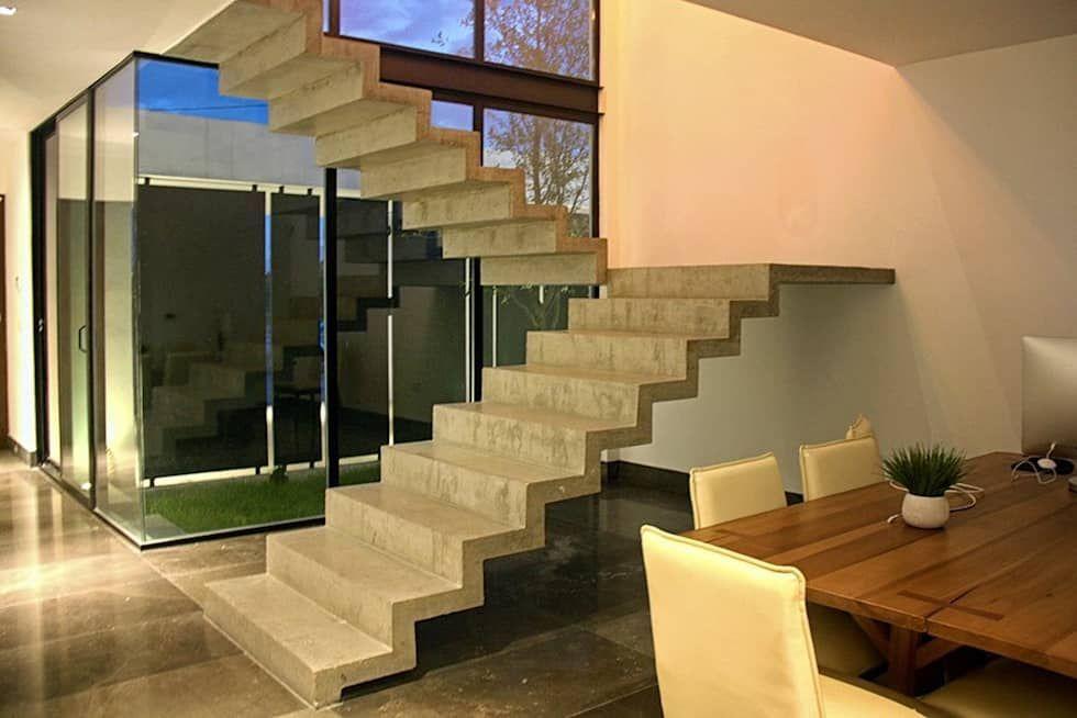 Escalera concreto aparente pasillos y recibidores de - Diseno de escaleras interiores ...