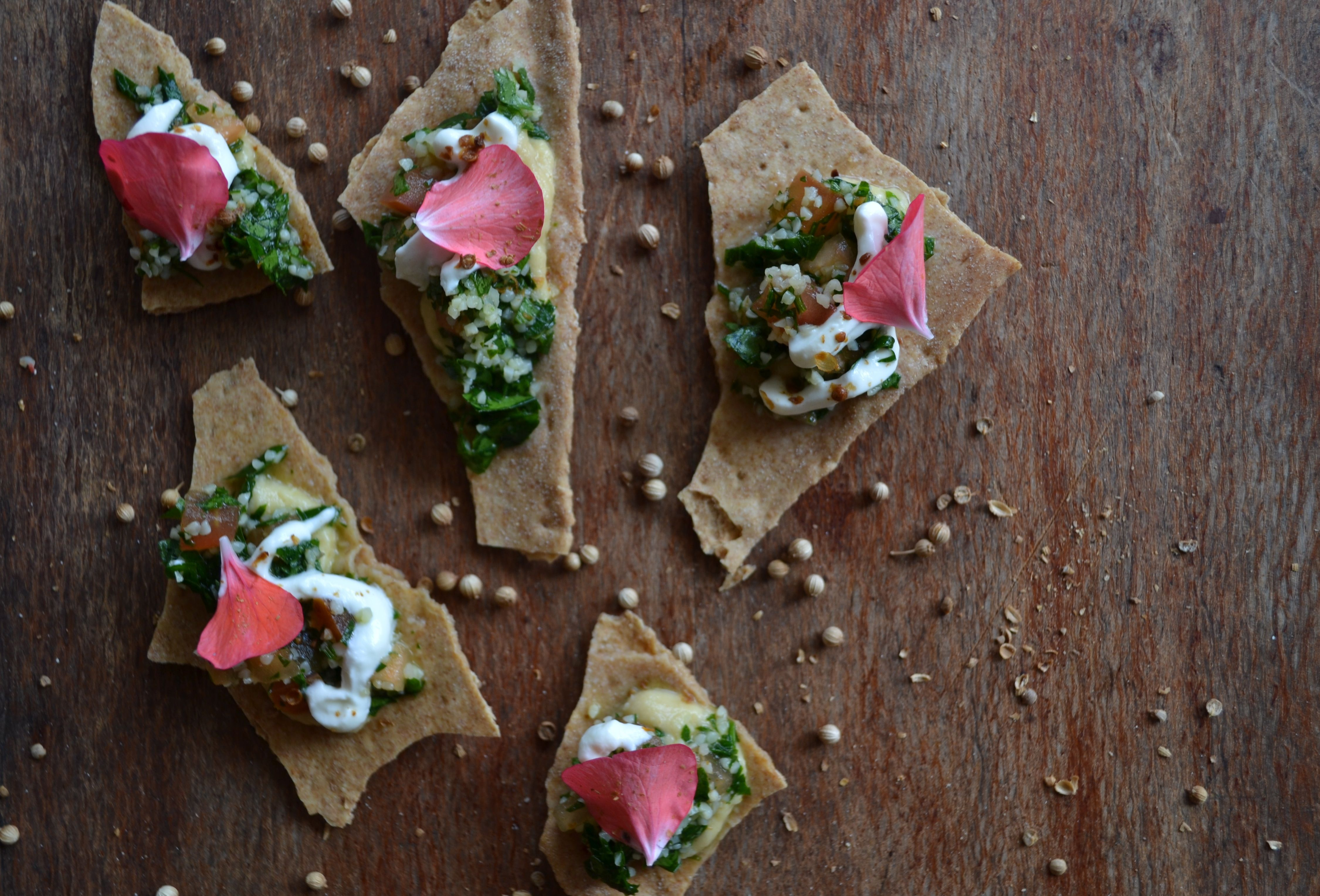 Don't Cry over Spelt milk - Coriander seed crisps with tabour, chickpea smash, labneh & geranium petals. A Collaboration between Kate Olsson @heytucker & HealthyBYTe. Image by Camilla Anderson