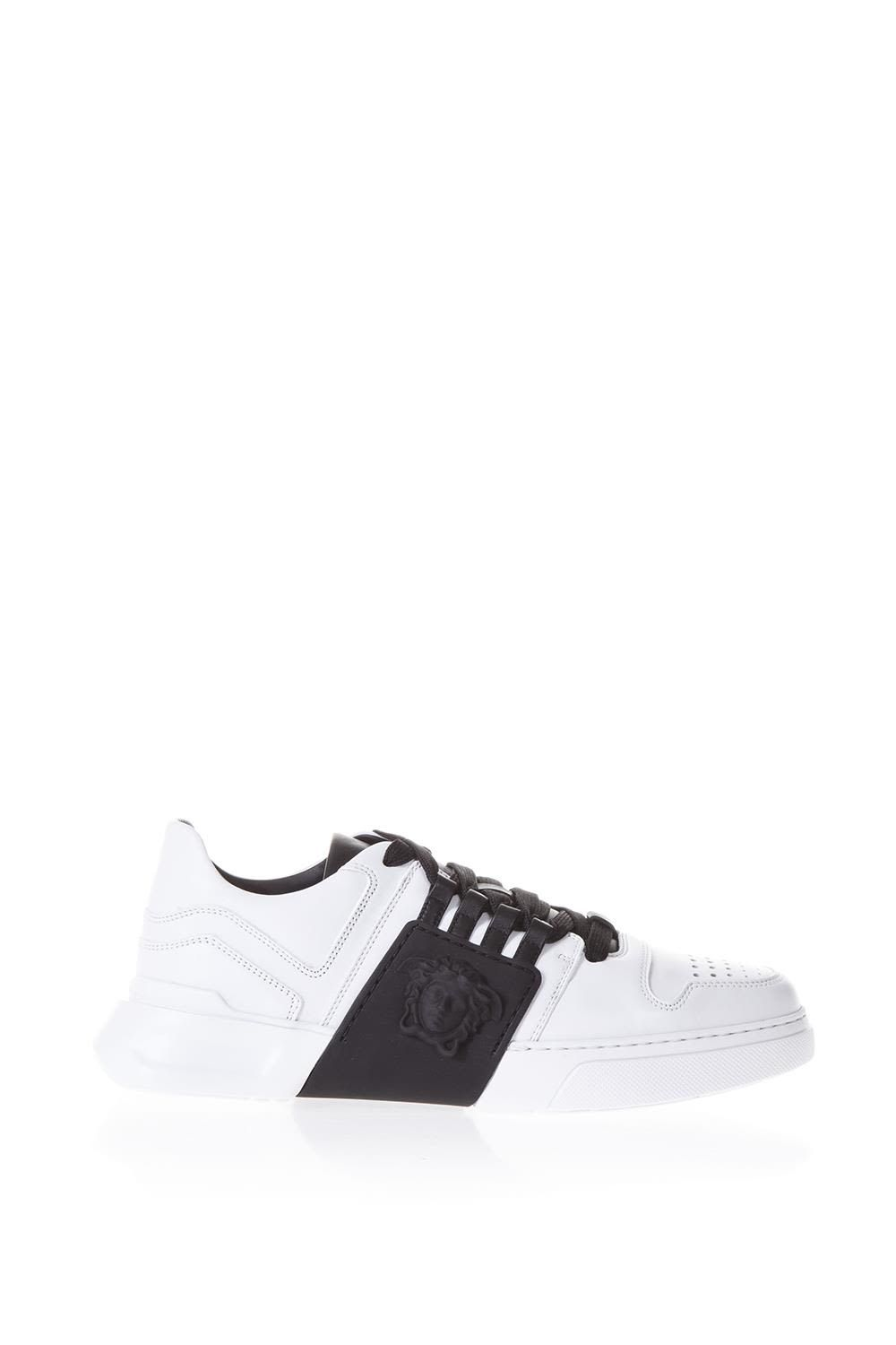 69feaa3ea5 VERSACE BICOLOR LACED SNEAKERS IN LEATHER. #versace #shoes   Versace ...