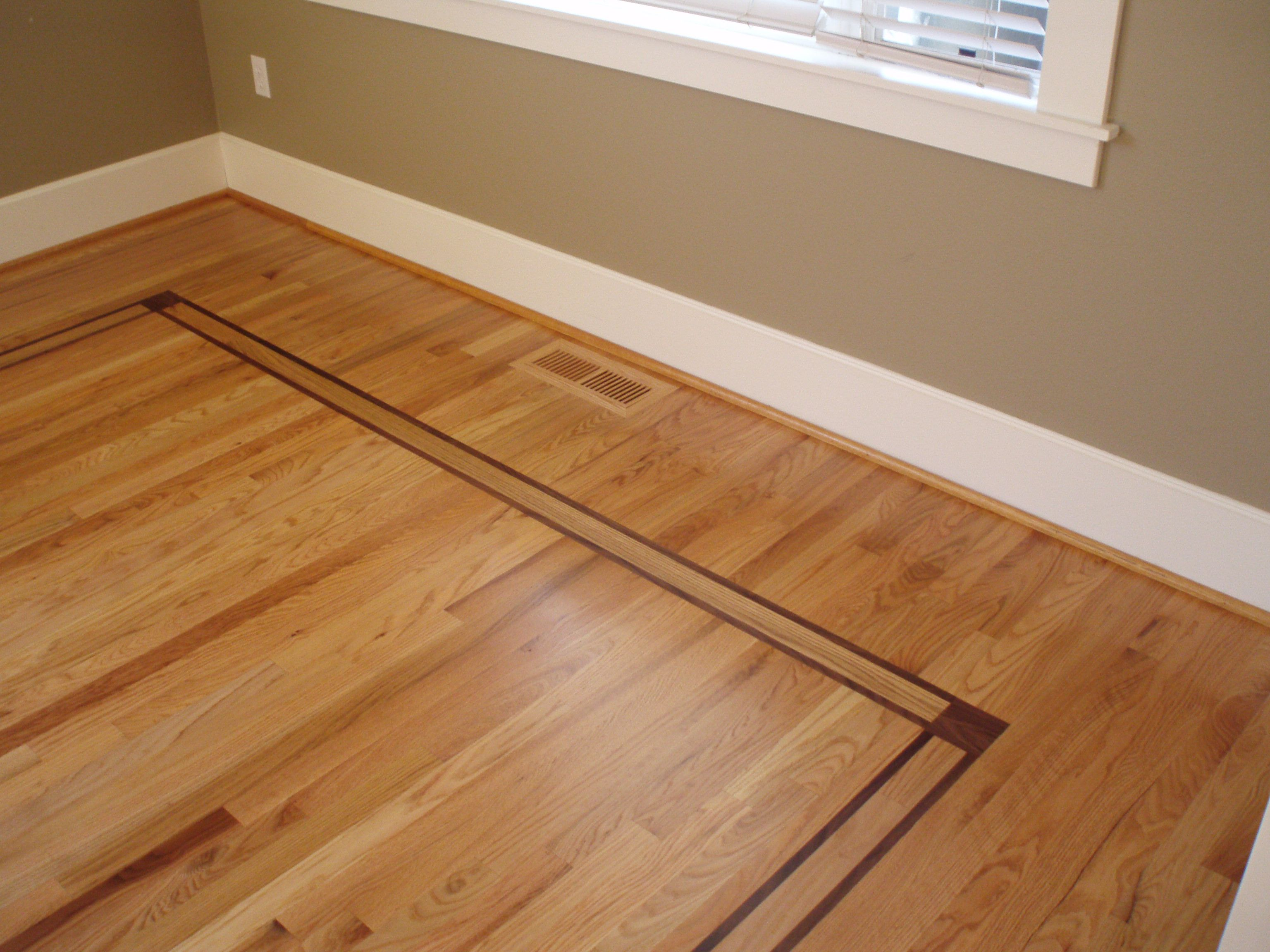 Inlay of walnut with red oak flooring www