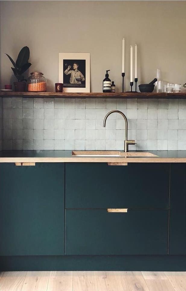 A deep emerald green. Warm beige walls, brown single shelf …