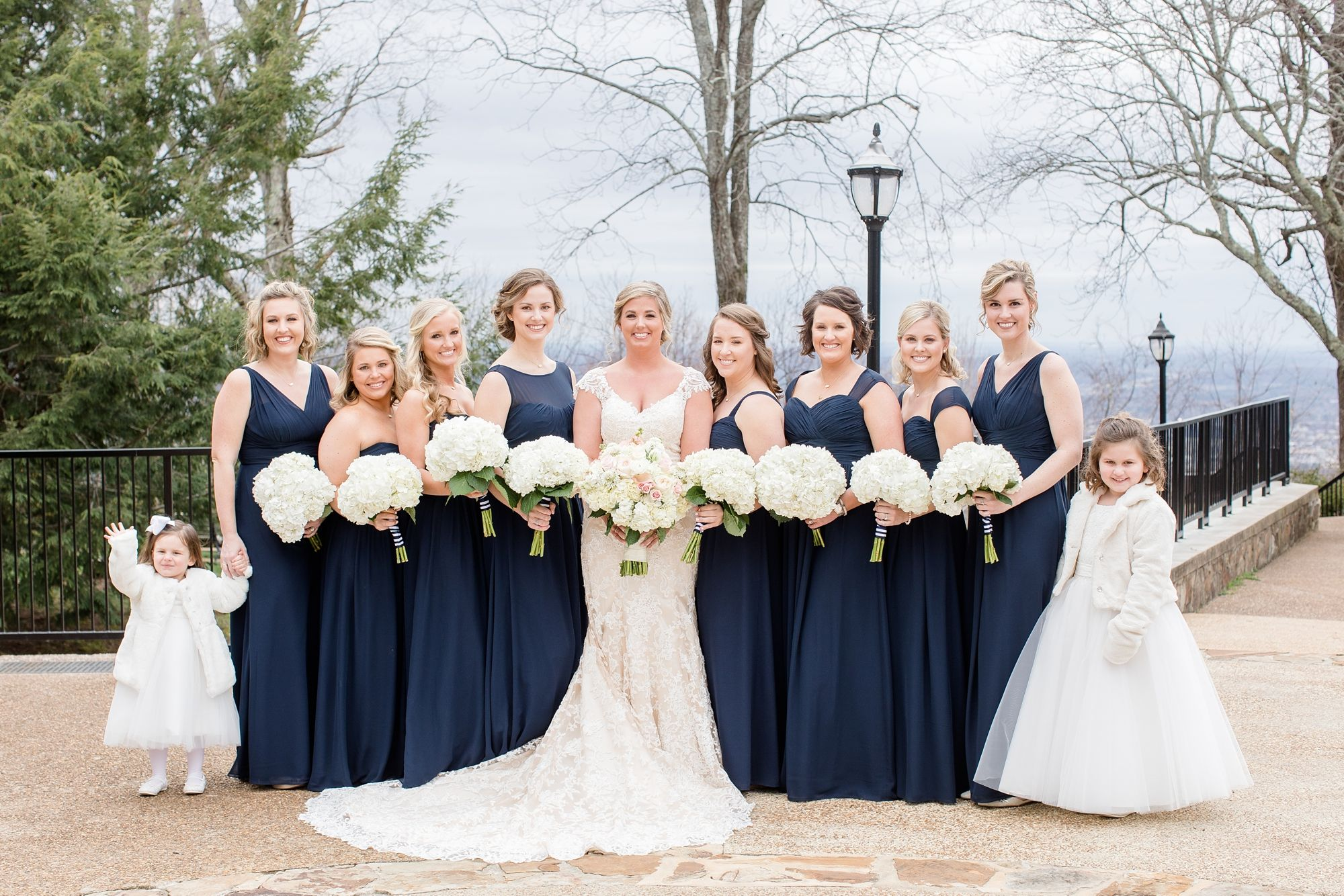 Winter Wedding With Navy Bridesmaid Dresses On Top Of The Mountain