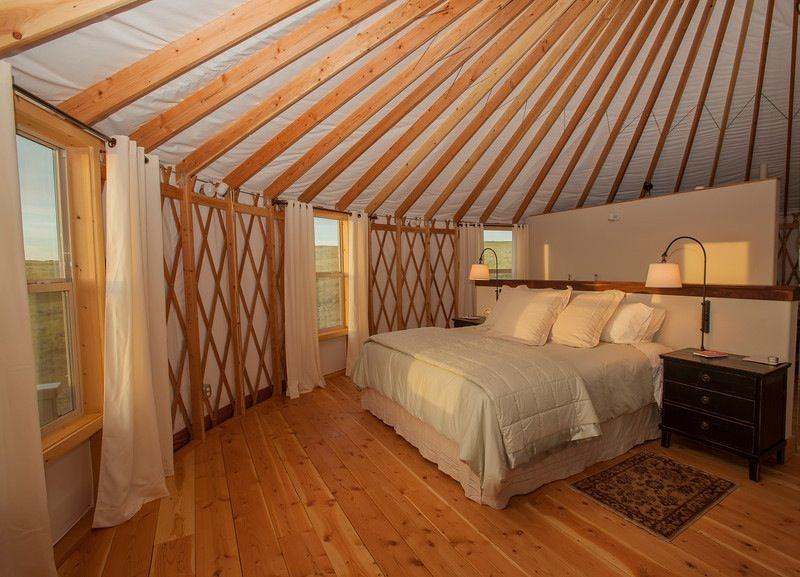wwwshelterdesignsnet Cozy bedroom in a 30 Shelter Designs yurt