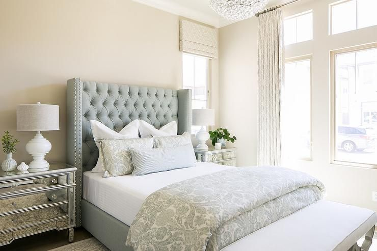 elegant blue and beige bedroom boasts a tall blue tufted wingback rh pinterest com