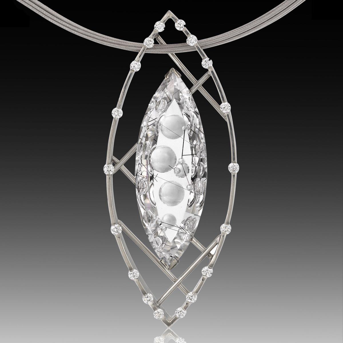 Polar ice quartz pendant rutilated quartz gold set and quartz