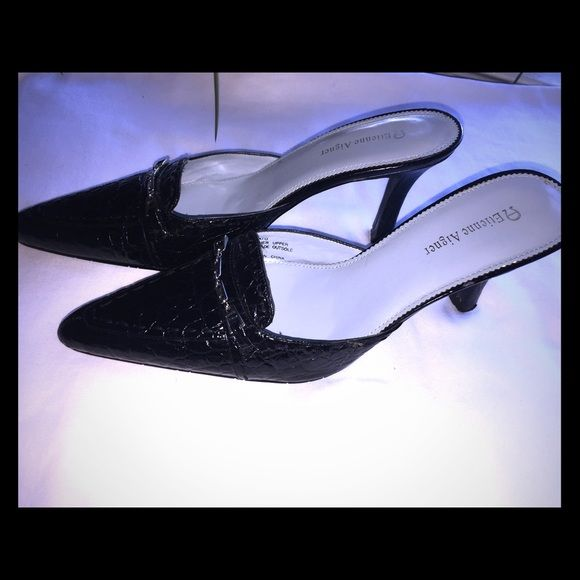 Etienne Aigner Etienne Aigner stunning classy black with silver hard ware shoe. Size 8. Wore once. Great condition. Looks brand new Etienne Aigner Shoes Heels