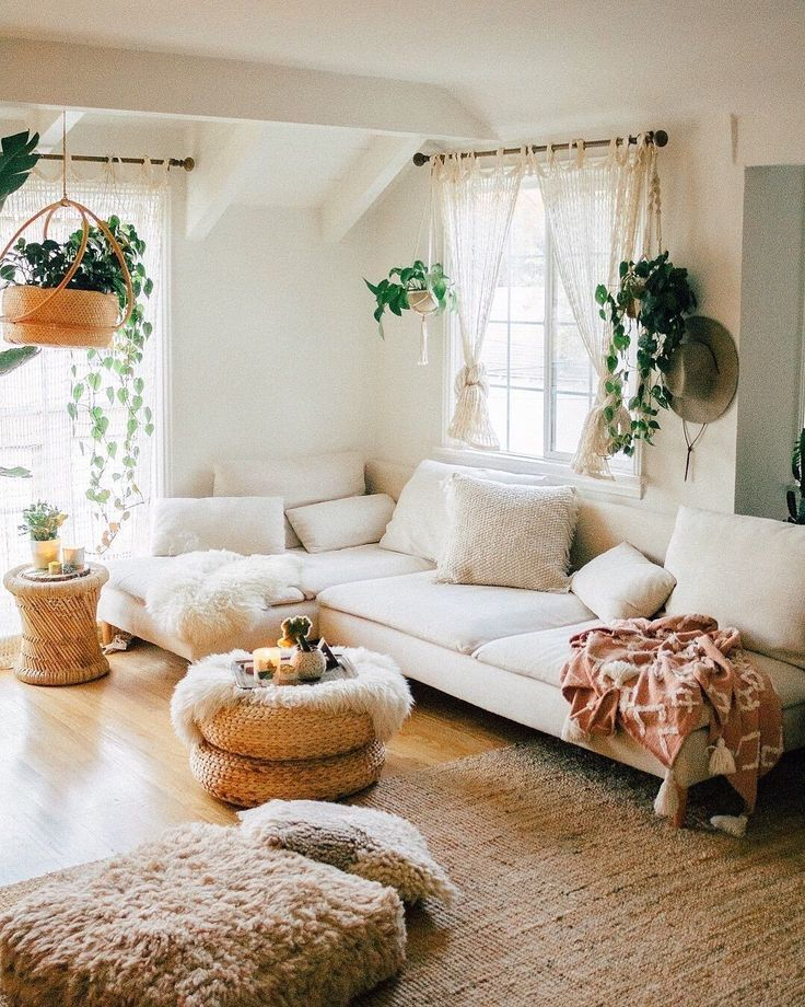 Cozy Modern Homedecor: Cream Colored Living Room With Brown Rattan Rug, Plants