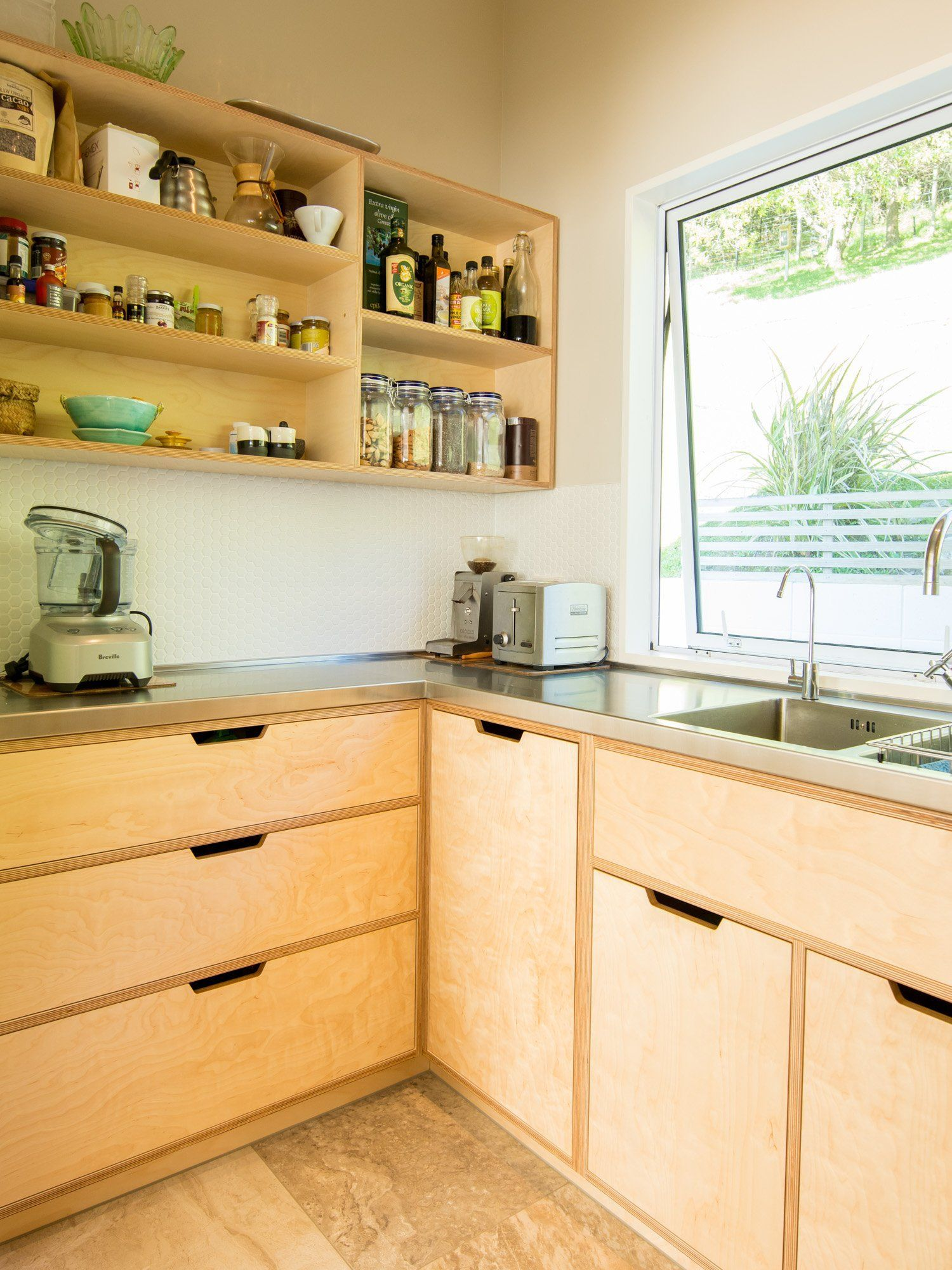 Crisp, simple and modern plywood kitchen. Oiled Birch plywood and