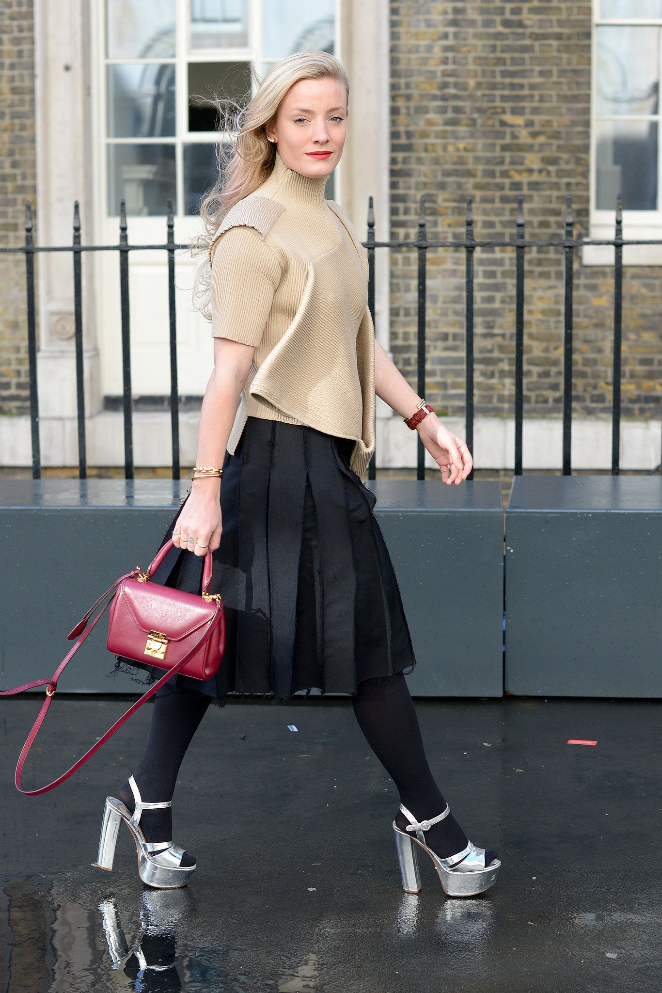 She nailed the head-turning effect with a pair of silver platforms. Street Style at London Fashion Week #LFW