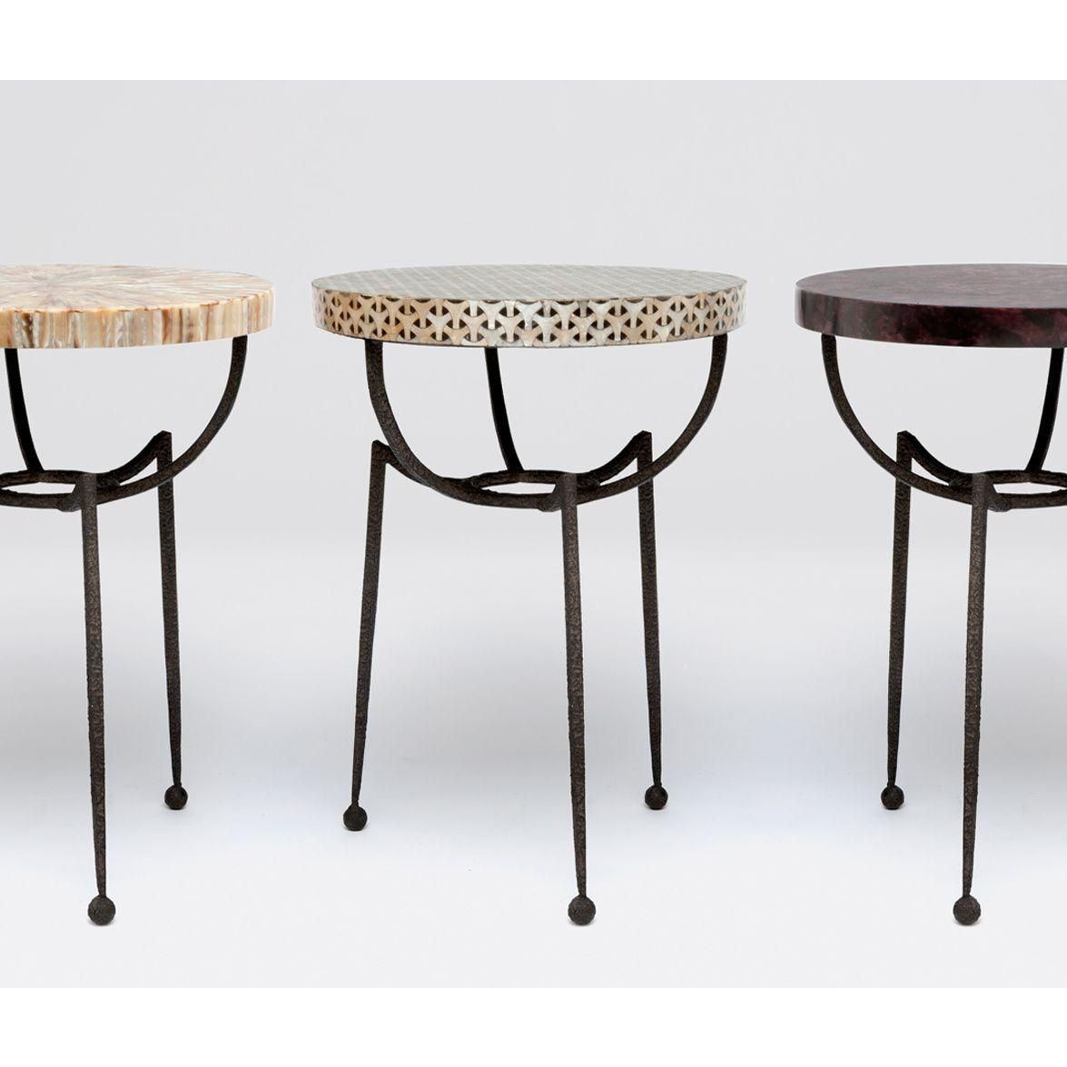 A new inter changeable table base Thin tapered legs form a