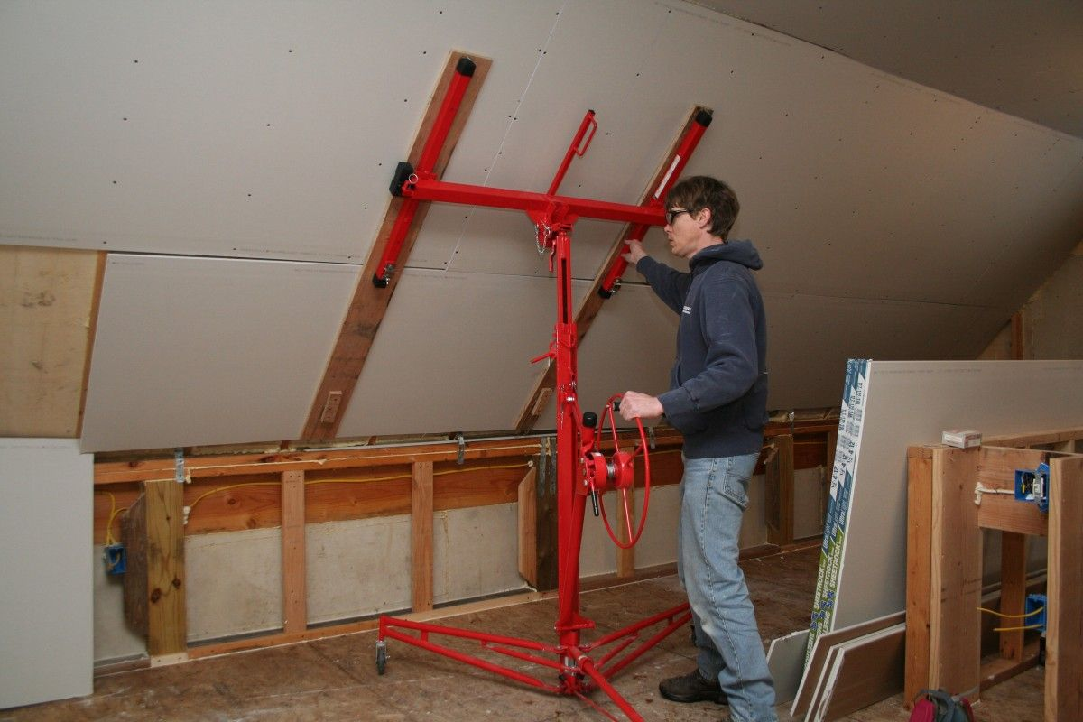Putting up drywall rent a drywall lift to make the job