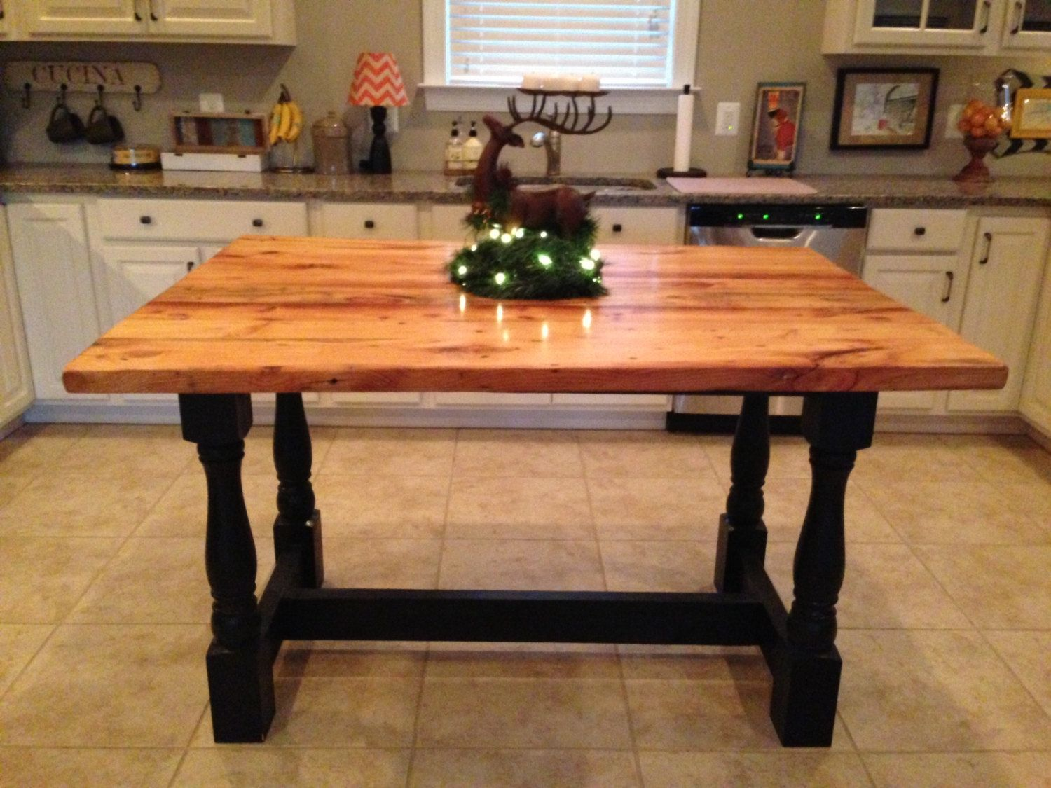 Harvest style kitchen island from reclaimed hardwood with turned
