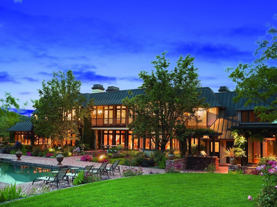 The backyard of the Orinda home offers a pool and large lawn. Photo: Bay Sotheby's International Re