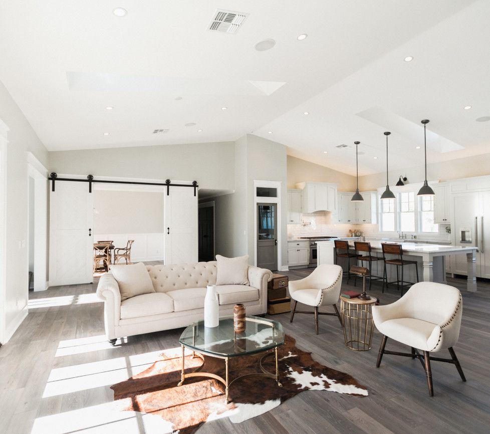love the sliding barn wood doors to separate the living room from ...