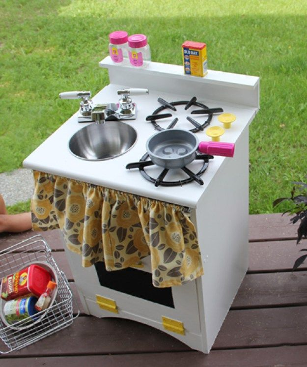 Make a Kids Play Kitchen with an old nightstand, a bowl, paint and hinges.