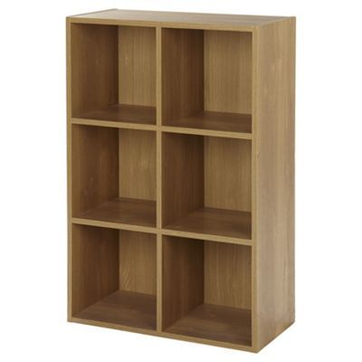 Part of the Vernon furniture range, this 4-shelf cube bookcase benefits from a simple design that works well with a wide variety of decor and room styles. The unit is finished in an oak-effect and features 4 fixed shelves that provide storage space for books, ornaments, photo frames and more. Team the bookcase with other furniture items in the Vernon range and give your living space a perfectly coordinated look. Requires self-assembly.