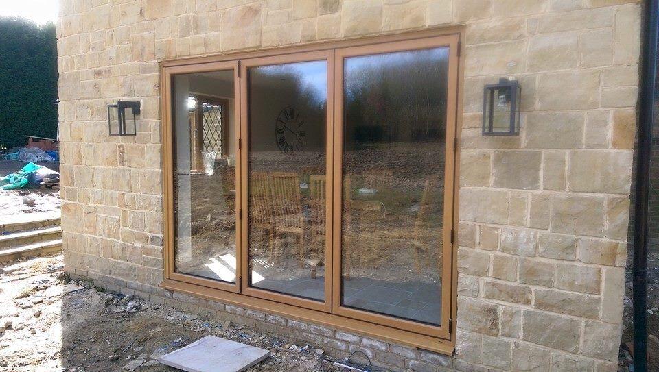 Smart system bi fold door in foiled oak effect | Maidstone trade ...