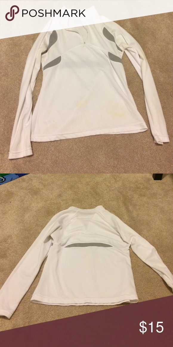 Work out top White 1/4 zip work out top by jockey. Very light, nice to wear over a tank top to the gym. Worn once, but only for a few minutes as it was slightly too small for me. 100% polyester. Jockey Tops