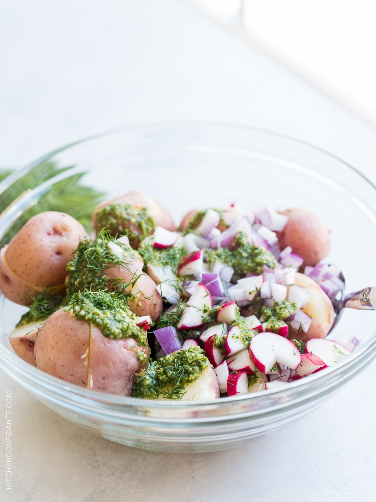 Chimichurri Potato Salad is the easiest feast to come off the grill! A simple chimichurri made with good olive oil and red wine vinegar adds zing to an herbed potato salad. Try it for your next barbecue!