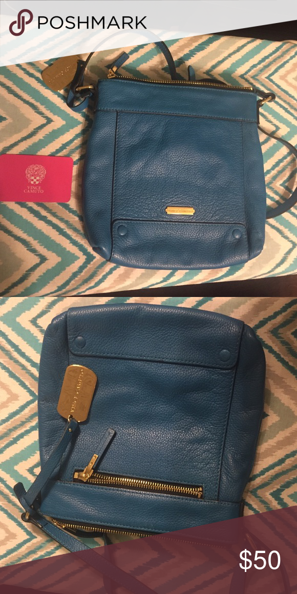 Bright Blue Vince Camuto Crossbody Bag Never used bright blue Vince Camuto Crossbody Bag. No tags/dust bag but has original card in purse (pictured in pink). Retail priced to comparable styles, sold as is. Vince Camuto Bags Crossbody Bags