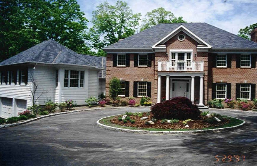 Either a full or half circle driveway curb appeal Semi circle driveway designs