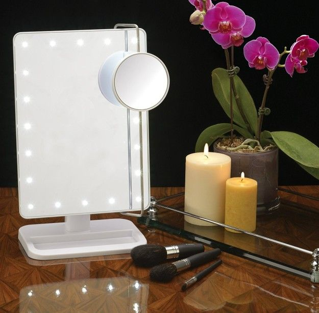 A Portable Vanity Mirror With Built In Led Bulbs And A Magnified