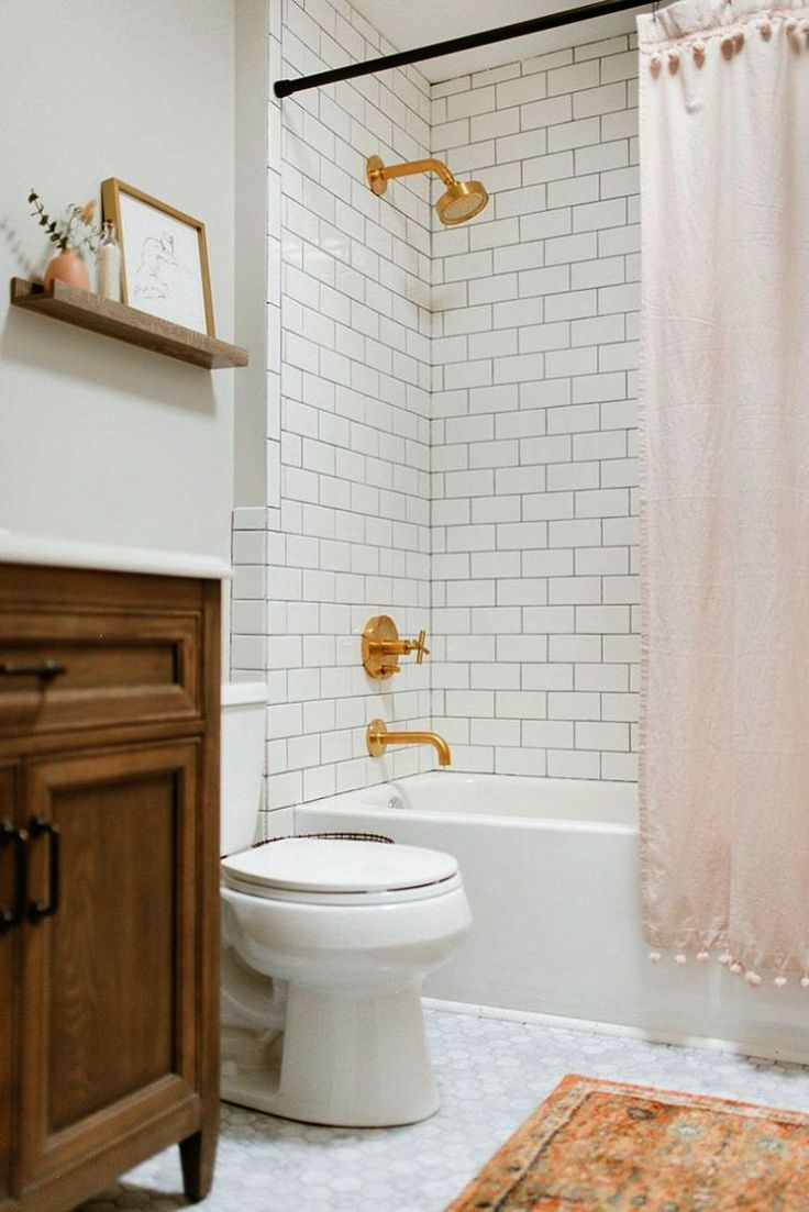 White subway tile in bathroom, gold hardware, blush accents ...